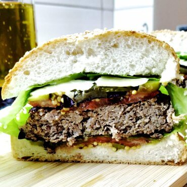 Homemade Burger with beef, pickles and Dijon mustard