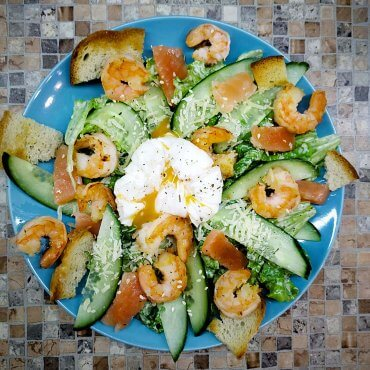 Shrimp salad with poached egg and salmon